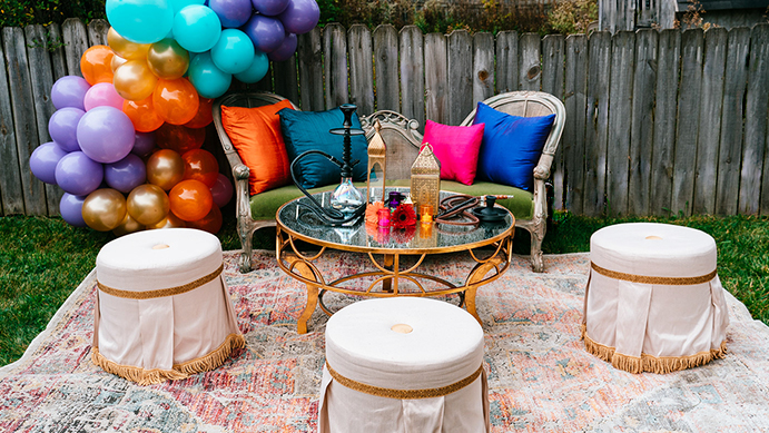 Lounge grouping, vignette, styling, event style, photo op, photo backdrop, event seating, Moroccan styling, theme event, balloon arch, balloon decor, fringe